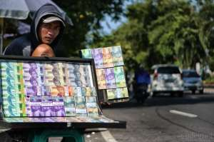 Jelang Lebaran Jasa Penukaran Uang Jalanan Mulai Ramai